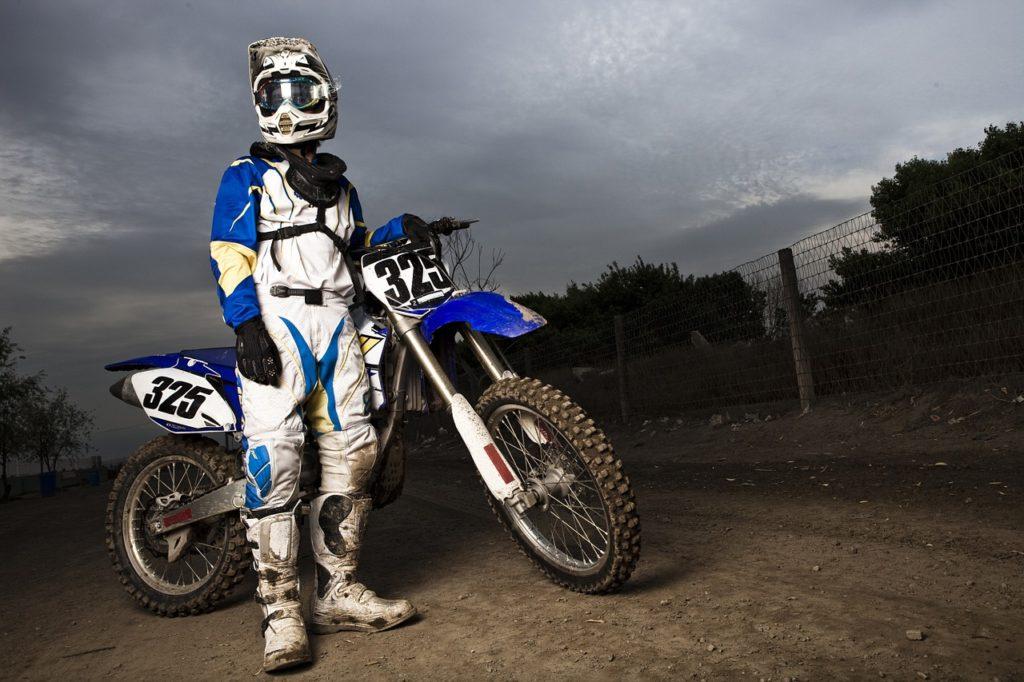 dirt bike rider standing